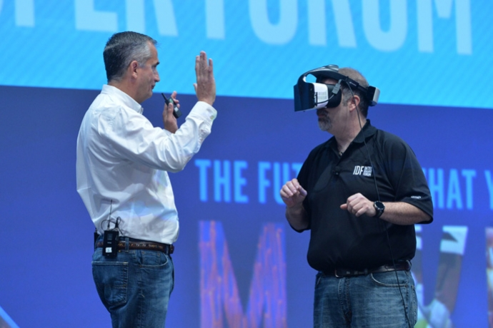 Intel's Craig Raymond displays the Project Alloy virtual reality headset during the Day 1 keynote at the 2016 Intel Developer Forum in San Francisco on Tuesday, Aug. 16, 2016.